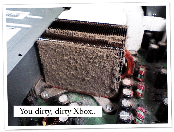 Close up of the inside of a dirty, dusty Xbox.