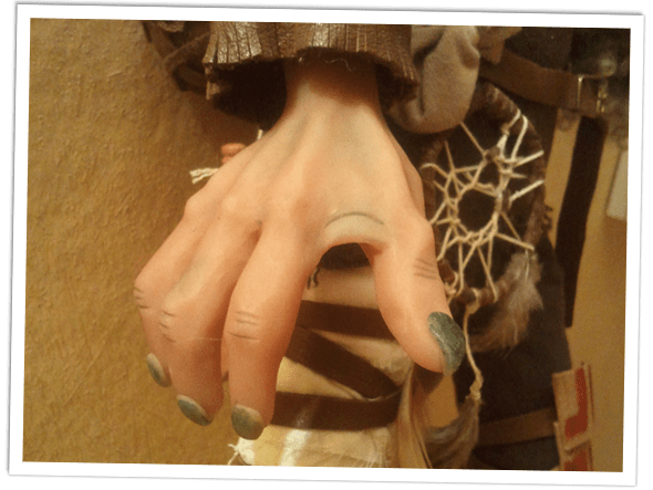 Close up of the hand details of the goblin doll.
