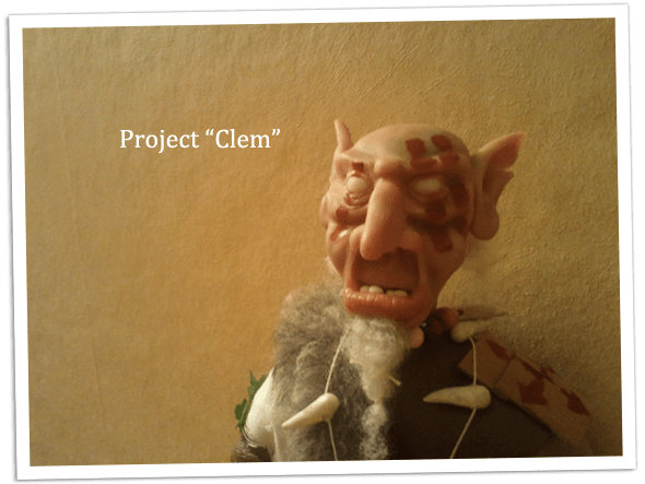 Close up of the partially painted face of the goblin doll.