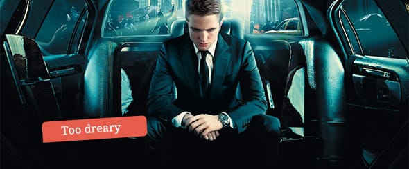 Robert Pattinson as Eric, sitting in his state-of-the-art luxury stretch limousine office.