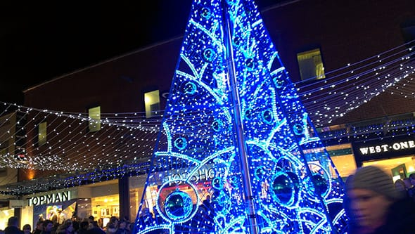 A gaudy bright blue Christmas tree on Fremlin Walk in Maidstone.