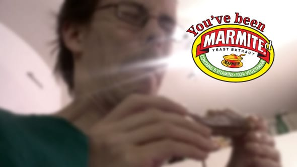 Carlos making a face of disgust as he tries Marmite for the first time.