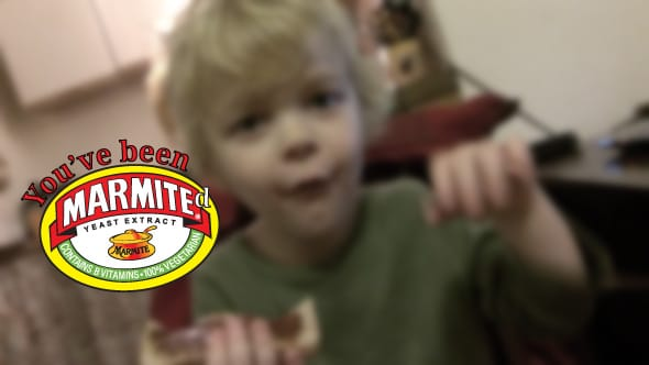 Lucien making a face of disgust as he tries Marmite for the first time.