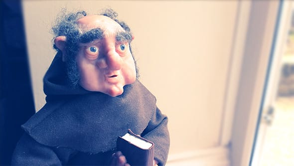 A Franciscan monk sculpted out of polymer clay.