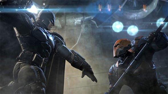 Batman fighting Deathstroke.