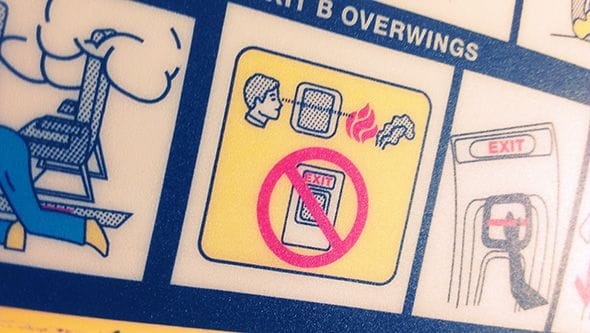 Close up of the safety instruction on our flight to Finland.