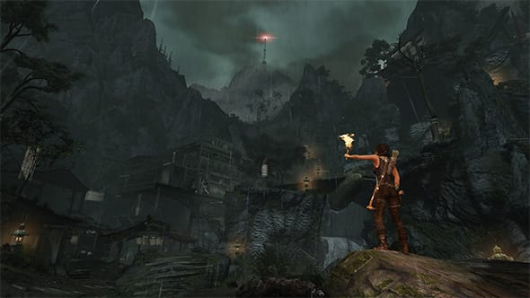 Lara Croft from the Tomb Raider game, exploring a cavern with a torch in her hand.