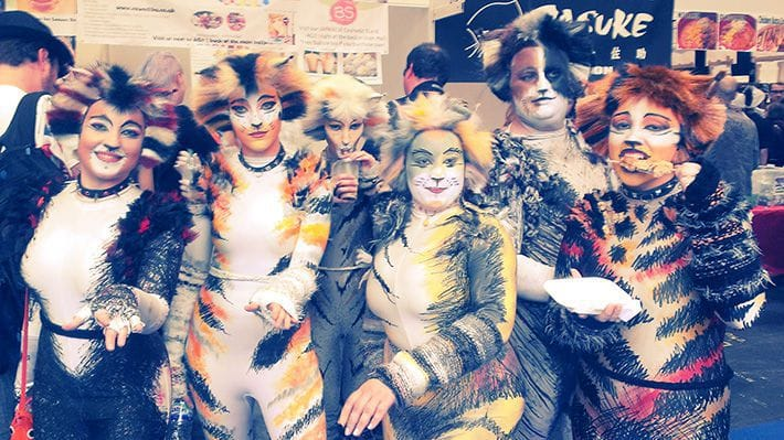 A group of people cosplaying as Cats with intricate costumes