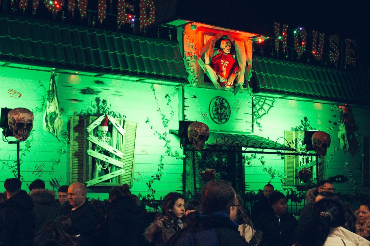 The Haunted House with its neon-green illuminated plastic skeletons.