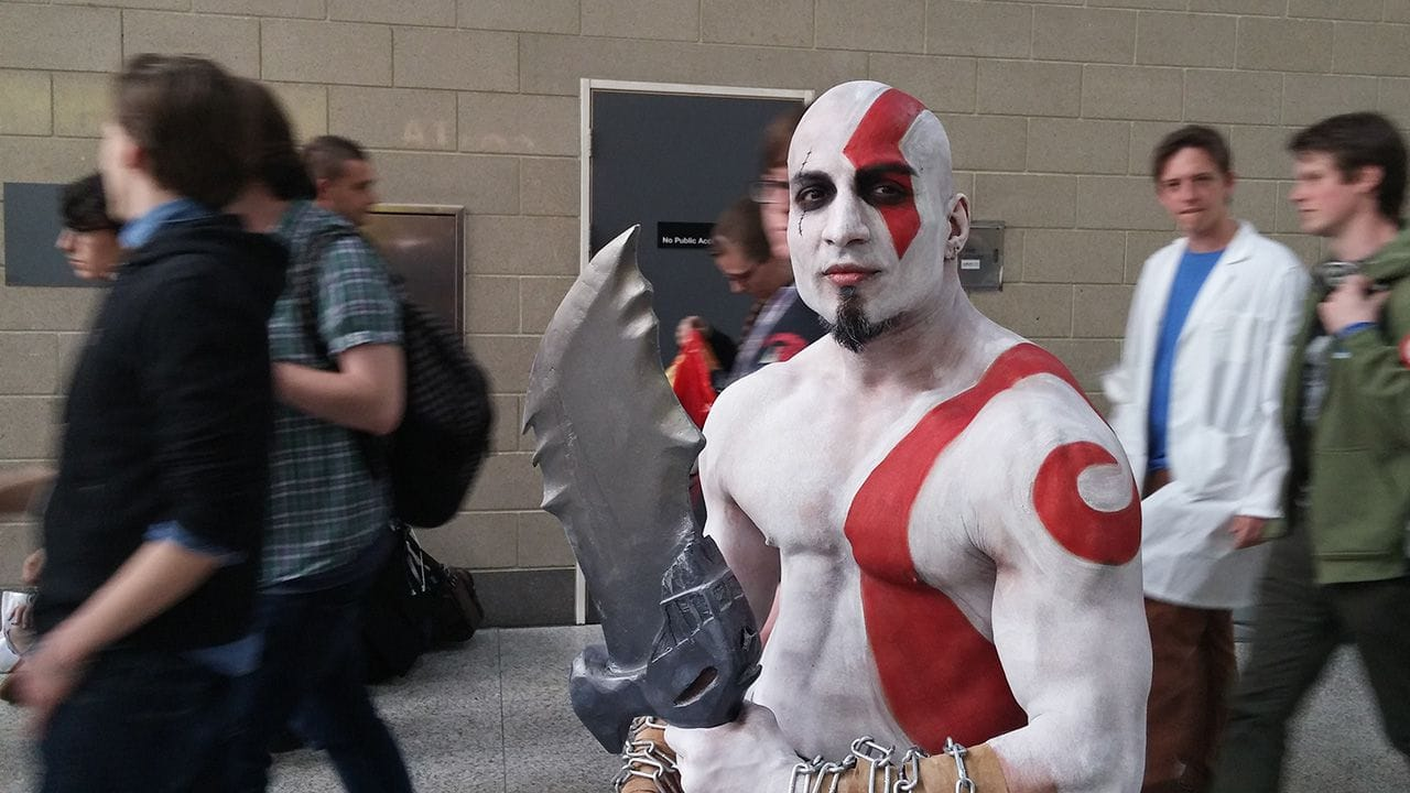 Man cosplaying as Kratos from the God of War game series.