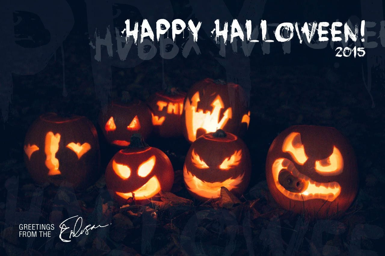 6 Jack O'Lanterns illuminated from the candles inside them and a Happy Halloween greeting from the Eriksson family.