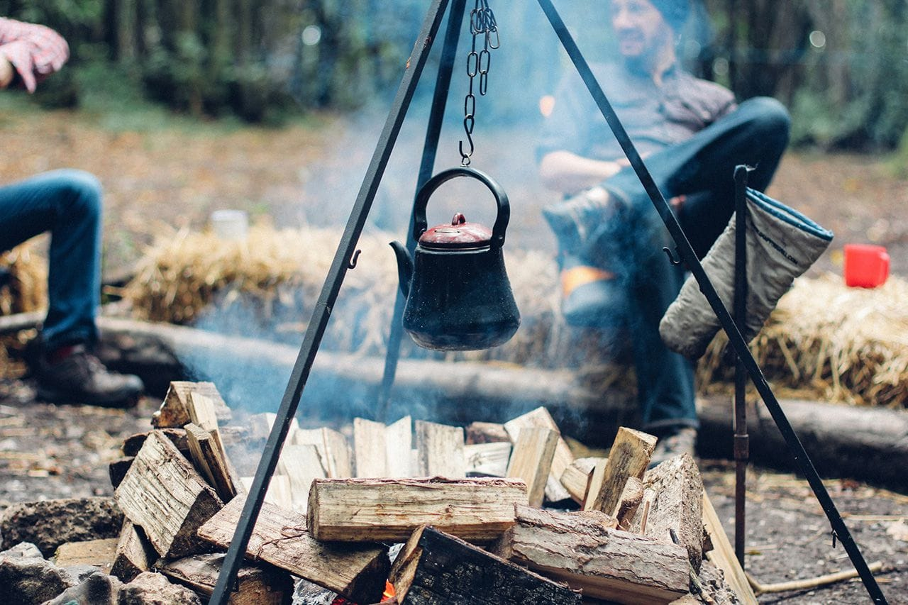 A kettle hung over the campfire.