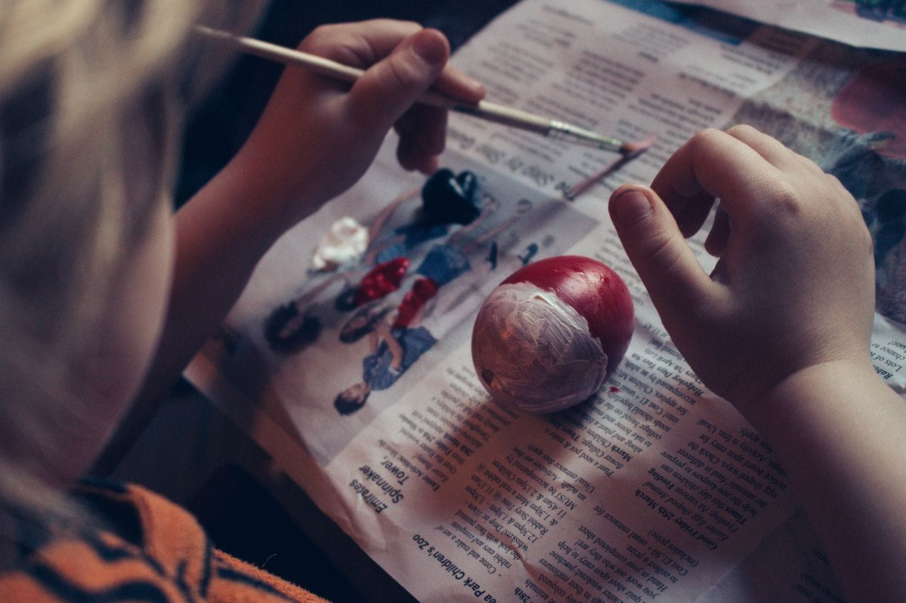 Lucien painting his Pokemon-inspired Easter egg.
