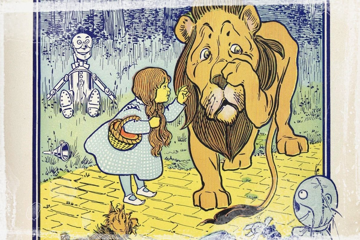 Dorothy reprimanding the cowardly lion as illustrated by W. W. Denslow.