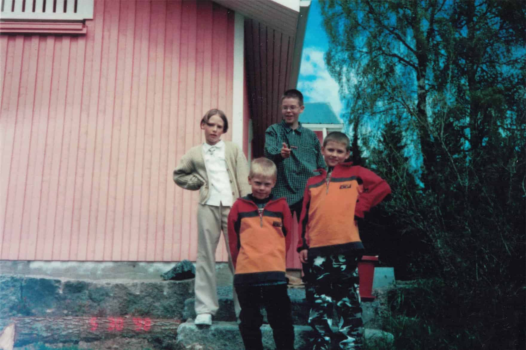 Carlos and siblings dressed as a Polish boyband, 1998.