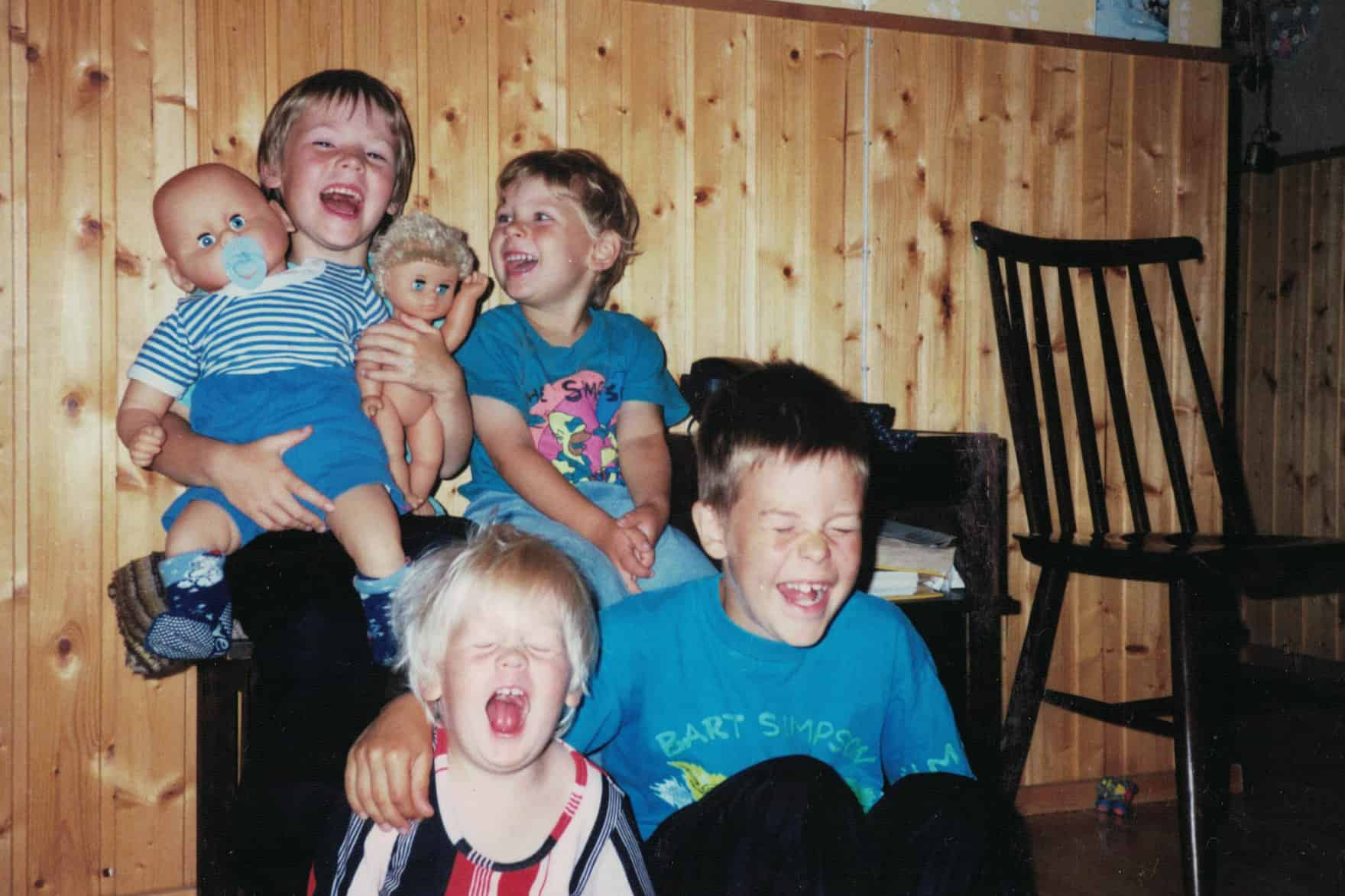 Carlos and siblings laughing hysterically, 1992.