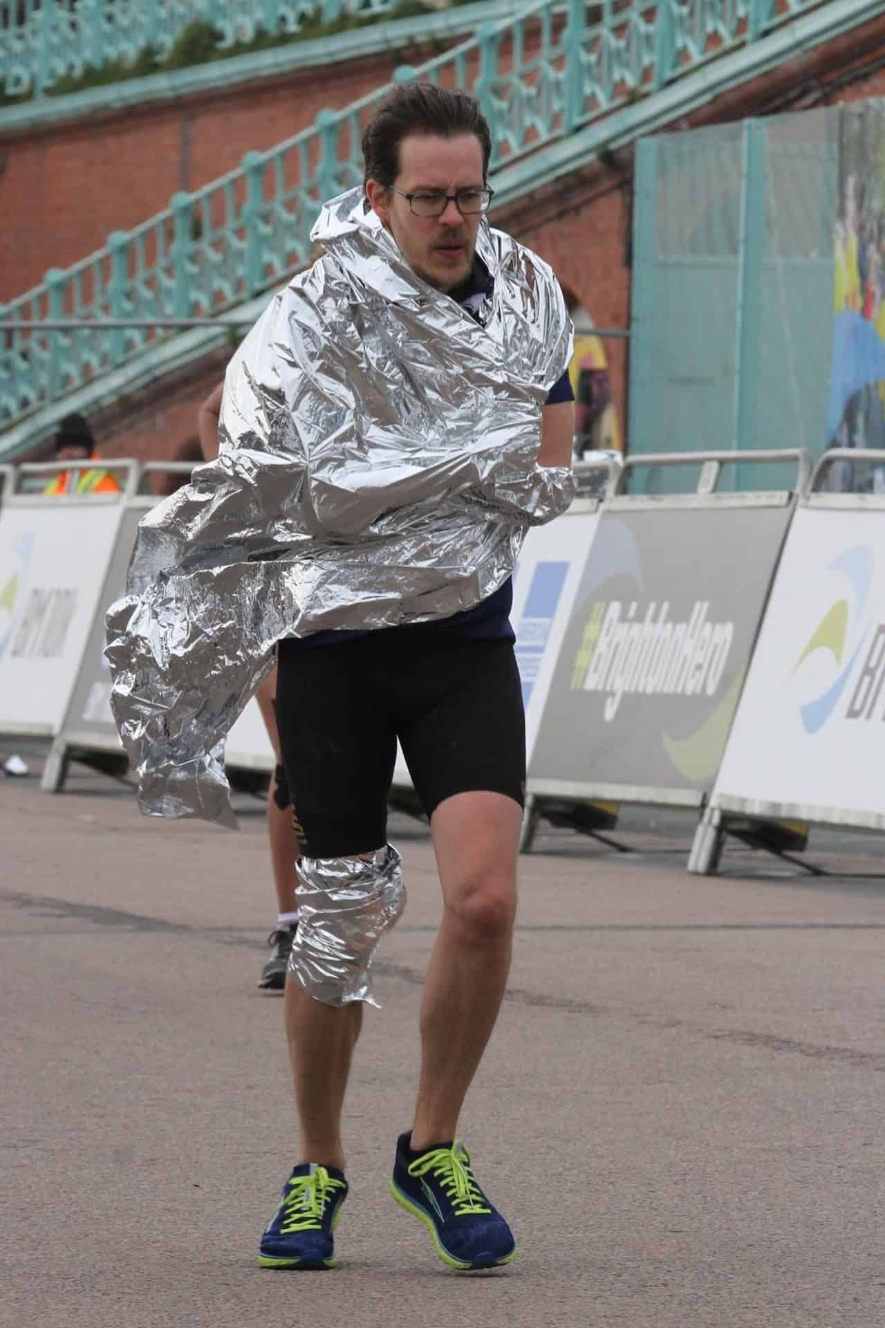 Carlos Eriksson wrapped in a silver blanket, pushing himself to finish the marathon.
